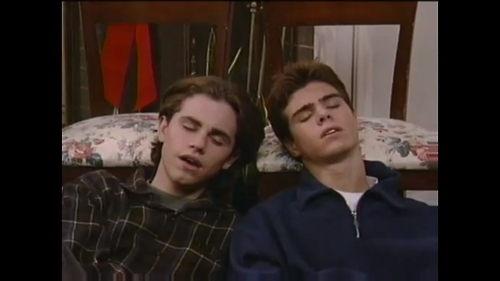 Matthew asleep with Rider Strong. :)