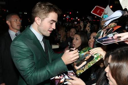 my honey at the BD 2 premiere signing autographs with a black sharpie<3