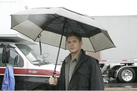 "Jensen on the set of ""Supernatural"" with an umbrella"