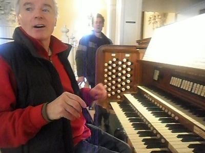 I have a tendency to like older men. The man in my icono is Roger Vine and he is waaaaaaaay older than me. [i](Here's a pic. He is wearing black and red. Roger plays the organ.)[/i] There is a lista of older men that I have a crush on. It's scary. Another thing is that I run weird. My hands go crazy and they flap everywhere so I have to hold something when I run.
