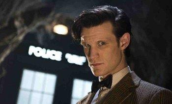Matt with the TARDIS windows behind him.