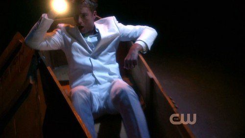 "Oliver freeing himself from the casket in ""Roulette"""