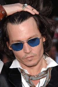 Johnny Depp wearing blue sunglasses