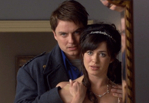 John Barrowman as Captain Jack Harkness with a pregnant Gwen Cooper.