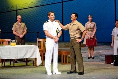 """Jensen in the stage production of """"A Few Good Men"""", wearing white shoes as a part of the Navy uniform <33"""
