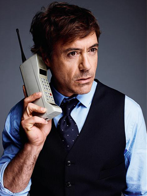 ROBert w/an old school mobile phone of the 80's HAHA