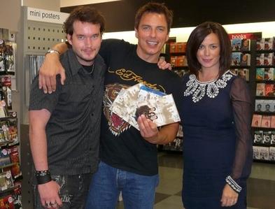 John Barrowman with Gareth David-Lloyd and Eve Myles touching him :)