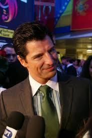 Sakis with a green tie.