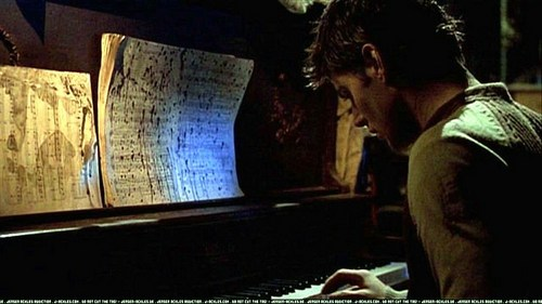 "Jensen sitting at the piano in ""Dark Angel"" <33"