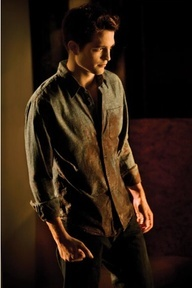 my baby in a scene from BD part 1 with blood on his shirt,which was from the birth of his daughter,Renesmee<3