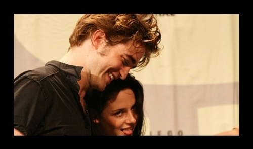 my sweetie Robert with Kristen Stewart at the 2008 Comic Con,who is making a funny face,by sticking her tongue out which my Robert finds funny<3