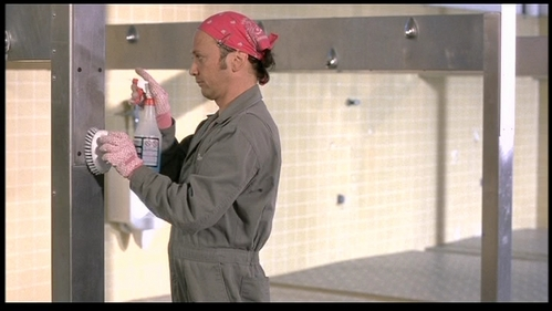 Rob Schneider carrying a spray bottle and a brush. :)