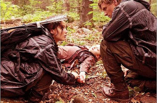well i think that she was desperate for food, and when she saw Peeta picking the berries she must probably wasn't thinking with her hunger taking over, so she ate the berries