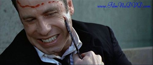 John Travolta as a villain in the movie, Face/Off who switched faces with Nicholas Cage. He went from a good guy, Sean Archer who works as a FBI to a terrorist, Castor Troy. Great movie. :)