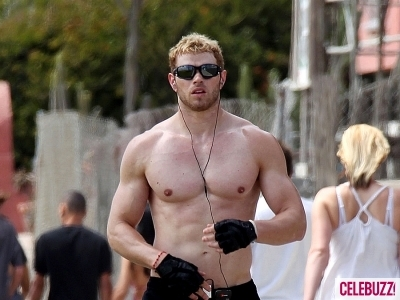 here's Kellan Lutz shirtless and working up a sweat as he goes for a run<3