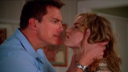 John Barrowman as Patrick Logan on Desperate Housewives :) He is looking for his ex and has murdered a woman.