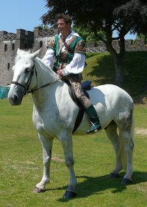 John Barrowman riding a horse :) Last año in panto, he actually got kicked off a horse and hurt his back :'( Poor john♥