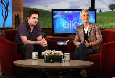 my handsome baby sitting on a red chair on the Ellen DeGeneres show<3