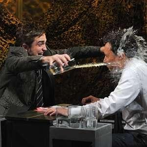 my baby throwing water at Jimmy Fallon.They were playing water war and they both were soaking wet at the end of the game,LOL!!!<3