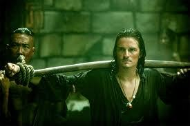 Orlando Bloom in Pirates of the Caribbean 3:At World's End all tied up<3