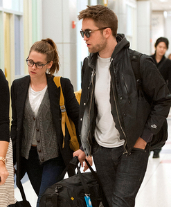 my sexy baby with Kristen Stewart,who is wearing glasses.Yes Robert is too(but he's wearing sunglasses)<3