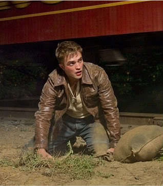 my baby in a scene from Water for Elephants in a brown leather jacket.OMG,my baby is wearing leather...I'm having jantung palpitations,and now I'm gonna faint...THUD<3