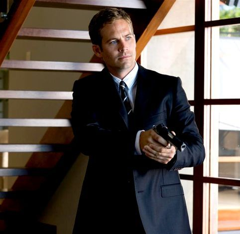 my 3rd fave hottie Paul Walker with a hand gun in the movie Takers<3