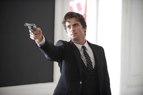 Neal Caffrey has a gun (Matt)