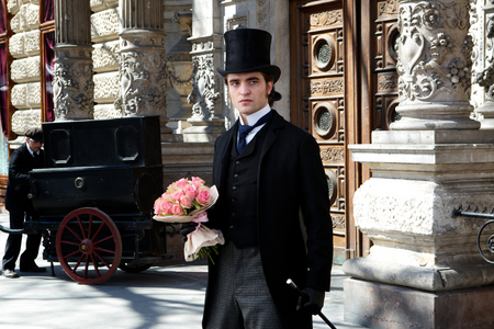 my baby in a scene from Bel Ami in a three piece suit.Aww,baby are those flores for me?How sweet and thoughtful.I amor them,thank you baby<3