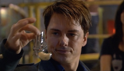 Captain Jack Harkness with a hand gun..LOL
