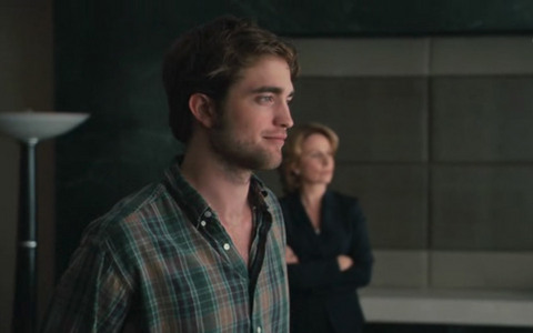 my baby in a scene from Remember Me waiting for his dad in his dad's office<3