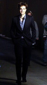 my handsome Robert walking and smiling<3
