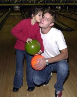 my sweetie with a very young Fan back in 2002 at a celebrity bowling tournament <333