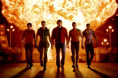 The Justice League, with the exploding 33.1 facility as the background <3333