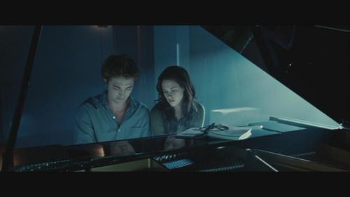 my sexy piano man playing the piano in a scene from Twilight,with Kristen Stewart(as Bella)seated beside him.Edward is playing the lullaby he wrote for her called,Bella's Lullaby<3