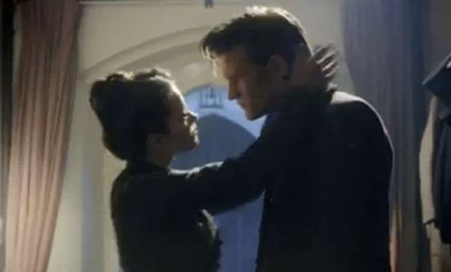 Clara trying to kiss The Doctor.
