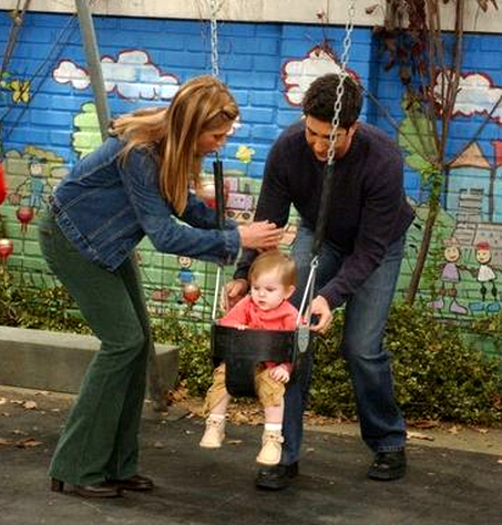 Jennifer Aniston with David Schwimmer pushing their child on a swing in Friends. :)