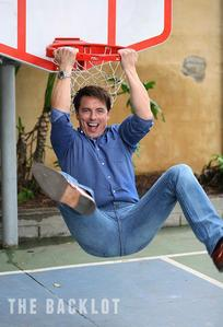 John Barrowman on a mpira wa kikapu ring in a playground :)