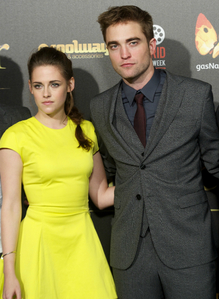 my handsome Robert with Kristen wearing a yellow dress at the BD 2 Spain premiere<3