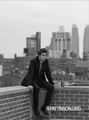 here's my sexy man on the edge of this ledge as he does promotional shots for Remember Me<3
