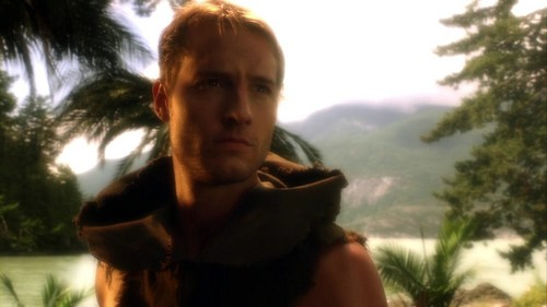 "Ollie in one of the flashback scenes in ""Toxic"", with some mountains in the back <3333"