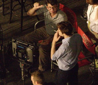 here's my gorgeous Robert on set of BD part 1,on location in Brazil,as he takes a cigarette break and listens to producer Wyck Godfrey<3