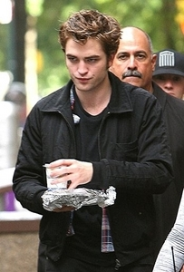 here's my baby holding a plate(covered in tin foil)on the set of Remember Me<3