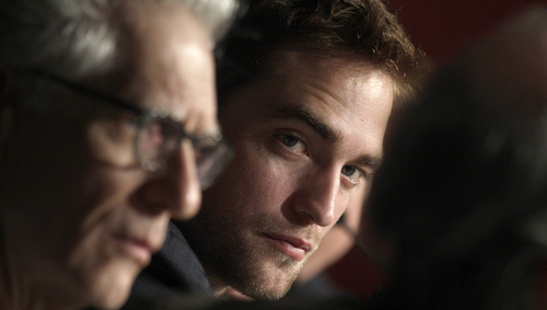 my gorgeous baby listening(and looking)at one of his Cosmopolis co-stars as they answer a question<3
