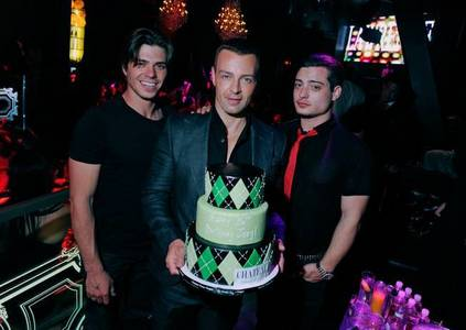 Matthew and his two brothers celebrating Joey's birthday. :)