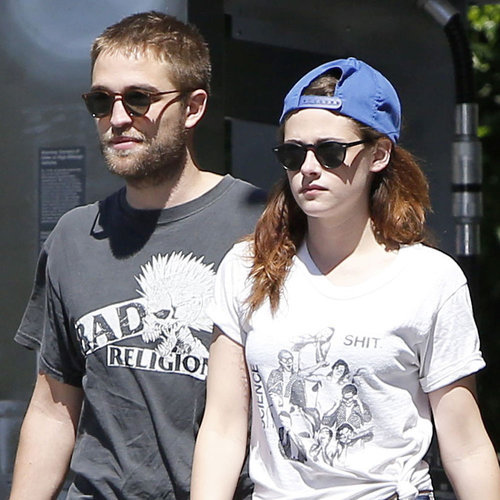 my handsome Robert with Kristen Stewart,who is wearing a hat as they stroll through the streets of L.A.<3