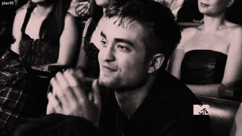 my handsome Robert clapping his hands because his sweetheart,Kristen had just won an award...aww,such a loving,supportive boyfriend<3