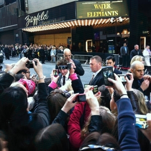my handsome Robert with a huge crowd just outside the Ziegfeld Theater at the Water for Elephants premiere<3