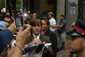 Zac his greeting fans (: