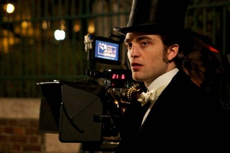 my gorgeous baby filming a scene for Bel Ami,with a camera behind him<3